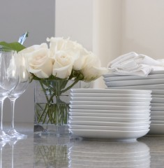 luxury home entertaining: flowers, plates, and cutlery
